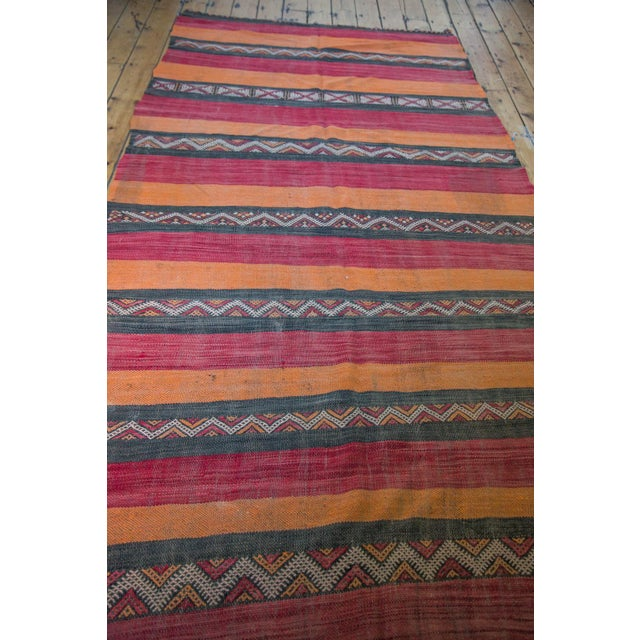Vintage kilim rug with alternating stripes in oranges, reds, charcoal and geometric serrated renderings! Will be a joy to...