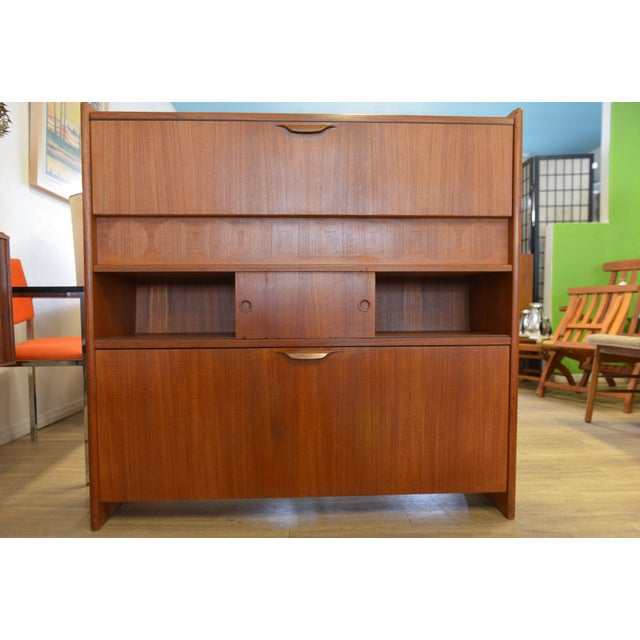 Designed by Johannes Andersen for J. Skaaning and Son in 1961, this teak dry bar is a perfect addition to your dining,...