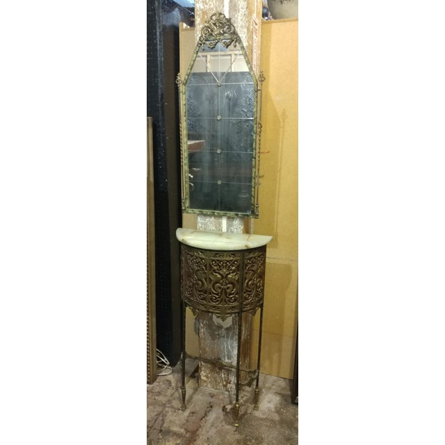 "An Oscar Bach gorgeous bronze stand with marble top & mirror, c.1900. size 20w x 10d x 38""h Mirror 16w x 1d x 36""h A..."