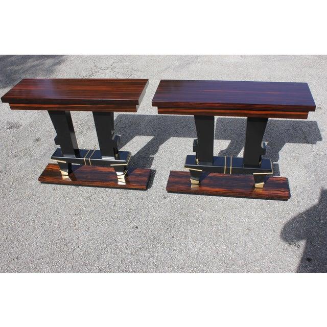 Classic Pair Of French Art Deco exotic Macassar ebony console tables, circa 1940s. Beautiful Macassar ebony with black...