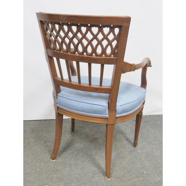 Italian style arm chair, hand carved fruitwood frame. Floral accents and latticework back.