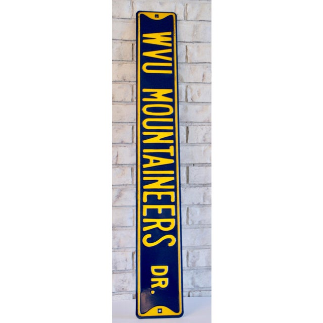 Perfect for a dorm room, family room, or den. This large scale blue & yellow sign mimics a classic street sign and reads...