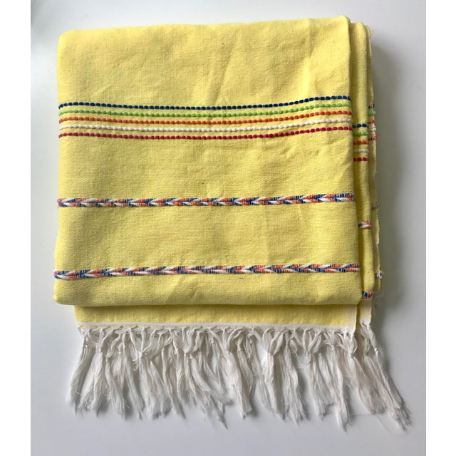 throw blanket/ bedspread in buttery yellow. This throw features multi-colored stripes with white tasseled ends. Would be a...