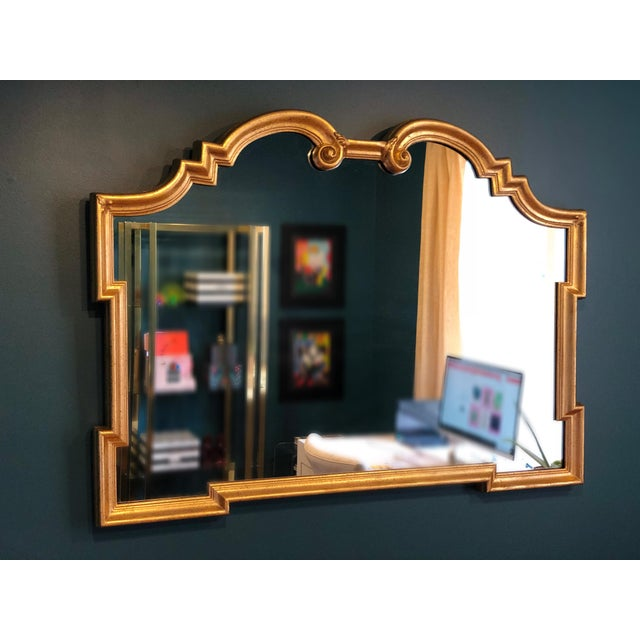 We are pleased to offer a stunning, elegant wooden mirror with a gilt finish by La Barge, circa the 1960s. In excellent...