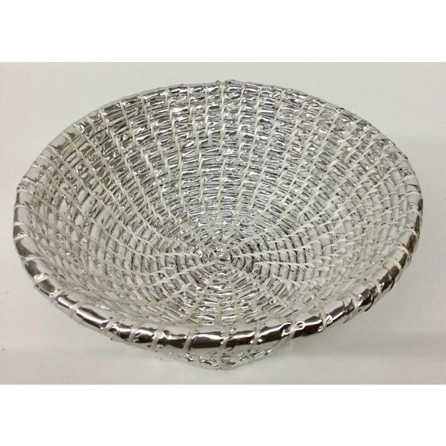 Very unique work of functional art. This bowl is light yet very sturdy. Made from up-cycled plastic in a bright silver...