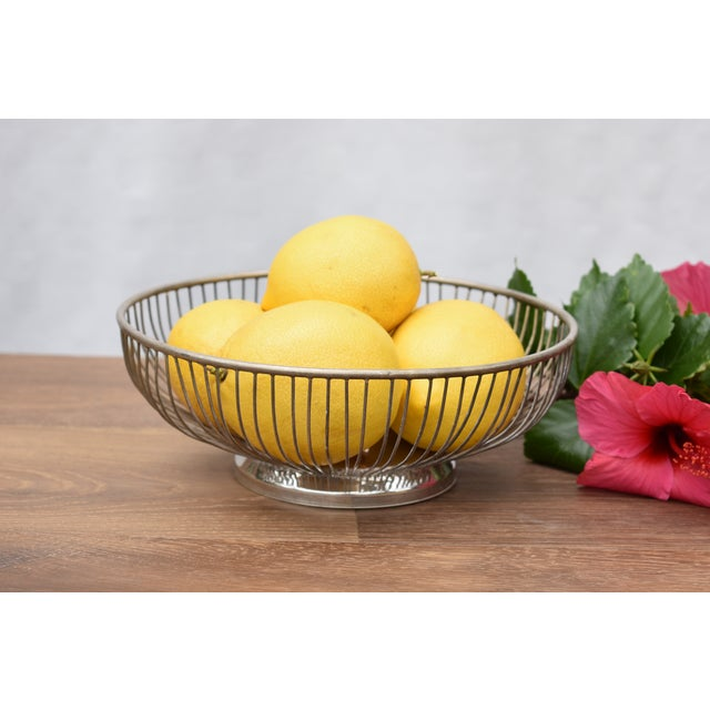 This is a vintage silver plated wire bowl. The piece is from the 1970s. Weight: 2lbs