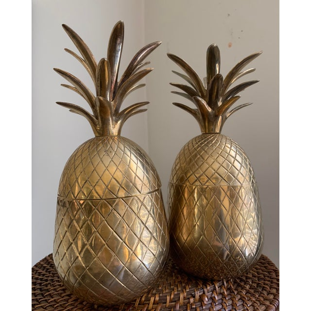 Beautiful matching pair of mid-century, hand cast and etched solid brass lidded pineapple containers. Very nice quality...