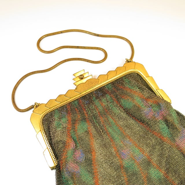 Offered here is a Whiting & Davis hand-tinted Dresden mesh purse from the 1920s. The very fine dark silver mesh, known as...