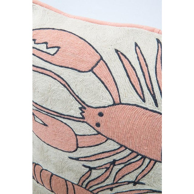 """""""Combining a soft harmonious colour palette of pinks and creams, the Lobster cushion is a playful design, typical of..."""