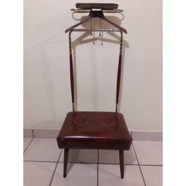Vintage Mid-Century modern coat rack, 'Mad Men' style. Stool upholstery with its original vinyl in mint condition. Wood...