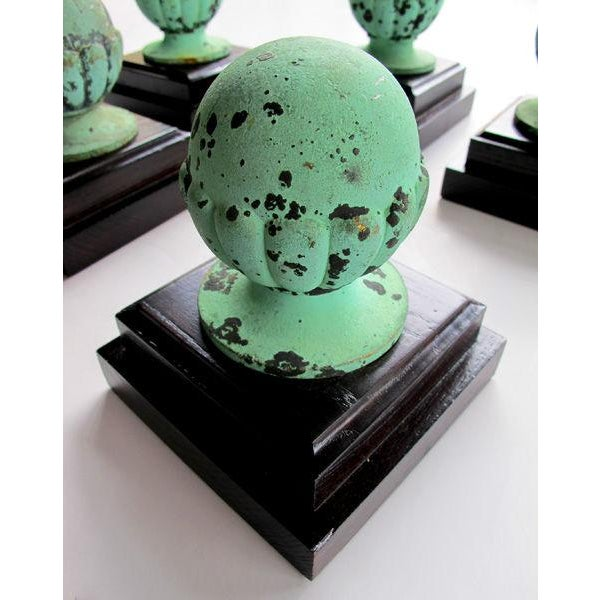 A well-patinated set of five American classical-revival verdigris bronze architectural spheroid finials; each lobed orb of...