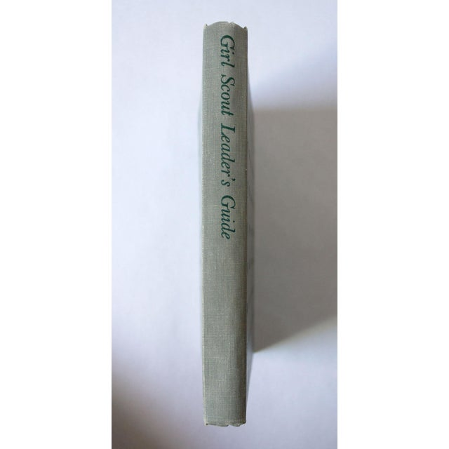 Beautiful grey copy of the Girl Scout Leader's Guide from 1955. Four-Leaf clover motif on the cover and back. Lovely...
