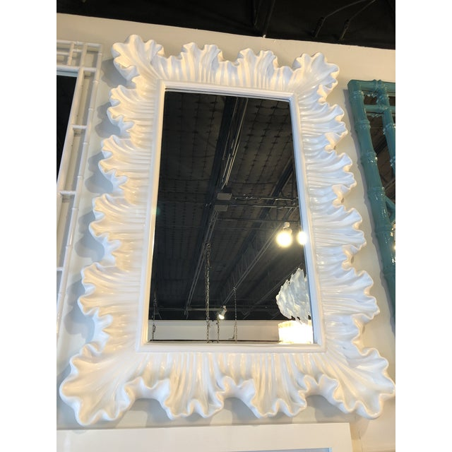 Beautiful vintage ruffle scallop wall mirror. Newly lacquered in a gloss white finish. This can be hung vertical or...