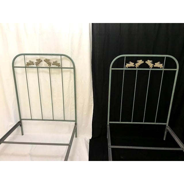 Twin Iron Bunny Beds by Corsican Beautifully handcrafted theme adorned with bunnies... hop to bed. The color resembles a...