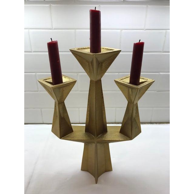 Burnished gold metal 3 light candle holder. Striking geometric cubist design. Engraved Tom Dixon on base.