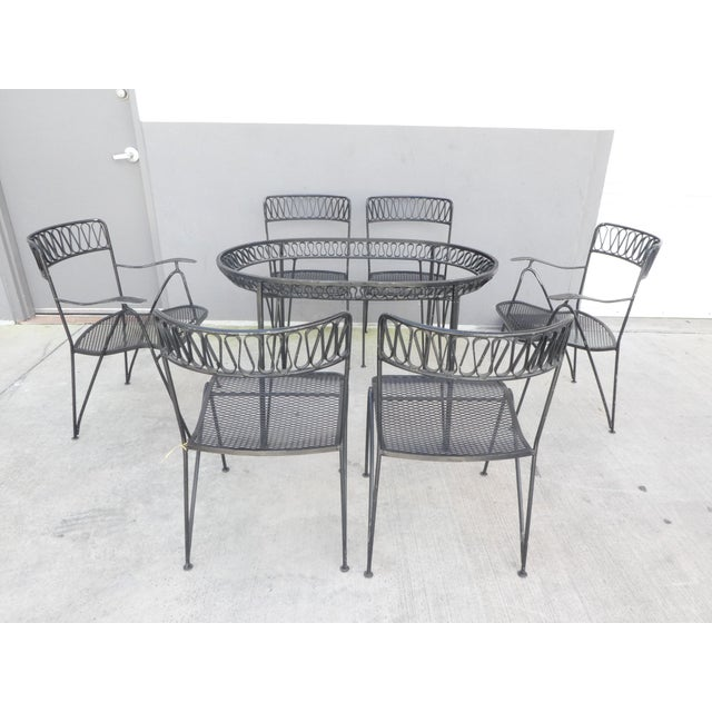 This is a vintage dining set by Maurizio Tempestini for Salterini. The pieces are in original condition with original...