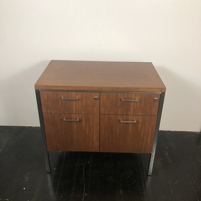 Wonderful 1960s modern walnut and chrome hanging file cabinet made by the General Fireproofing Co. Solid metal interior...