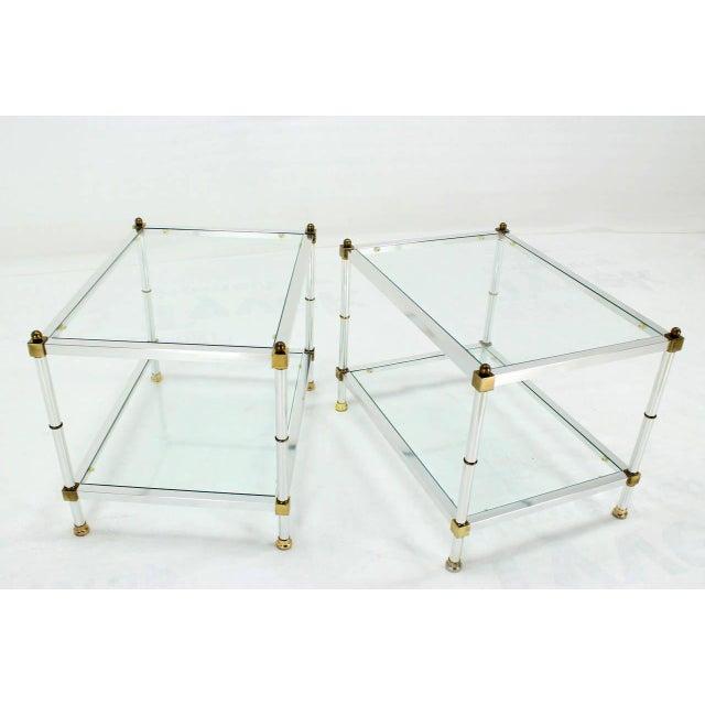 Pair of two tier mid century modern end tables. Glass bottom shelf. Nice rectangular shape.