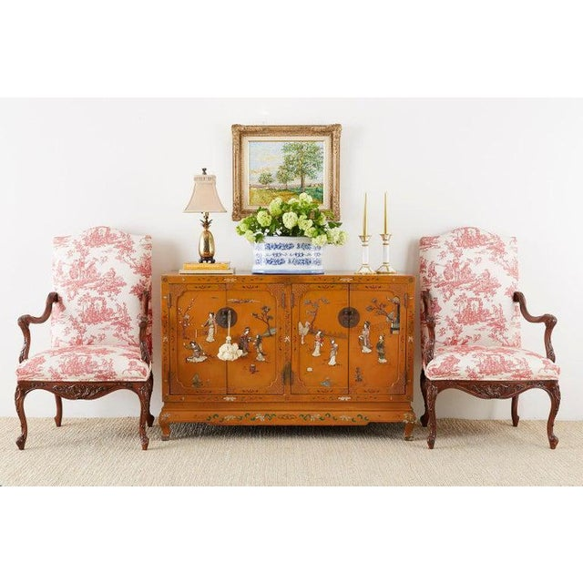 Impressive pair of carved walnut fauteuil armchairs or library chairs featuring a French Toile de Jouy upholstery. Made in...