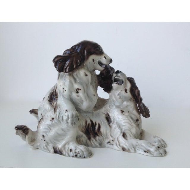 Vintage Italian porcelain glazed Springer Spaniels, or perhaps Cocker Spaniels, in a playful pose. Marked on underside,...