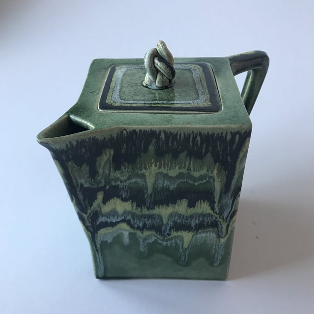 Stunning piece of California pottery for your consideration. Midcentury Modern Ceramic pitcher with green drip glaze...