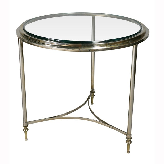 From the 1970s. Circular with glass inserts, three circular tapered legs and stretchers.