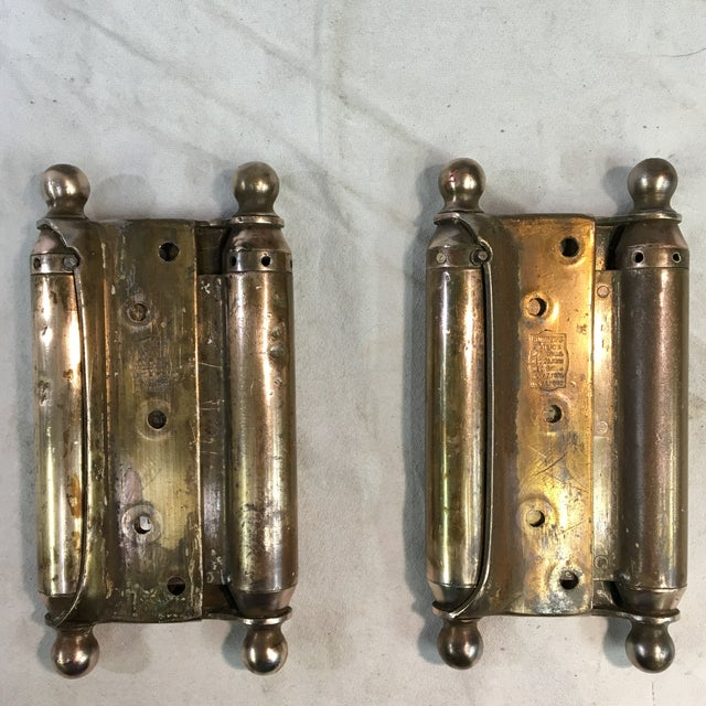 This is a pair of antique brass-plated door hinges intended for swinging doors/saloon style doors. These hinges were...