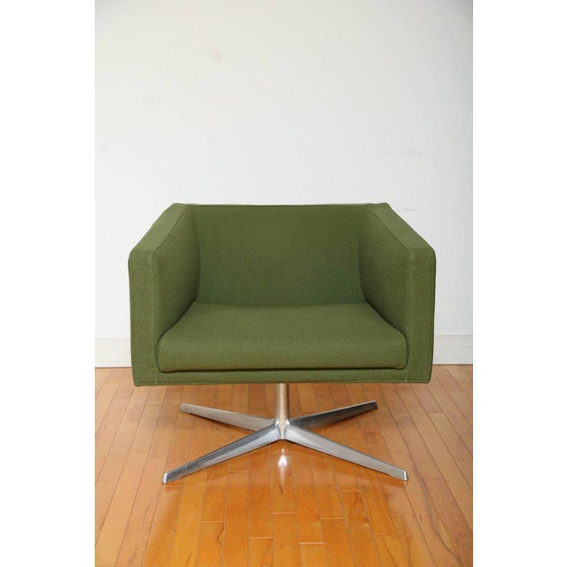 Cubica swivel armchair by Verzelloni. Features Mid-Century Modern design with cubist form, and full 360 degree swivel....