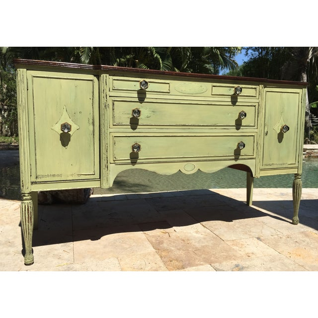 The seller says: This vintage mahogany sideboard was found in Tarpon Springs FL, home of the famous Greek sponge divers....