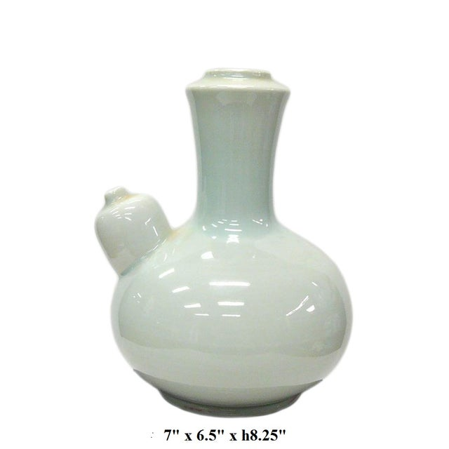 This porcelain vase has a layer of light celadon green white color glaze on the surface. It is a pure clean piece for home...