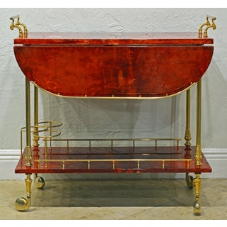Lacquered Red Goatskin Parchment and Brass Drop Leaf Bar Trolley by Aldo Tura Preview