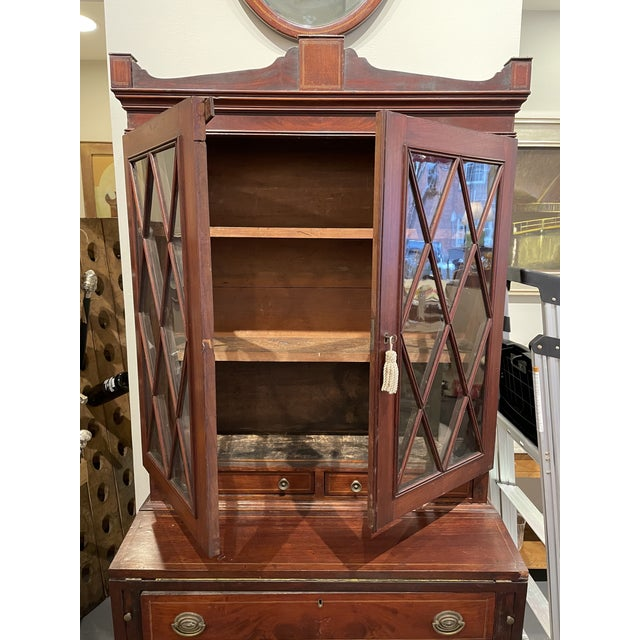 Two part secretary federal mahogany. Made in Massachusetts circa 1810. Features splayed legs.