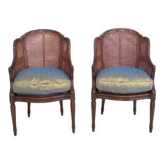 Theodore Alexander Cane Back Carved Mahogany Arm Chairs- A Pair For Sale