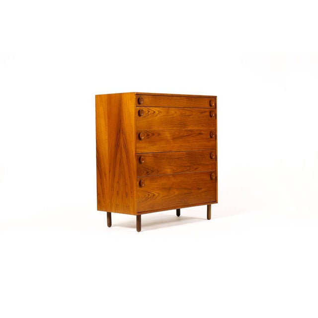 Great vintage dresser. Manufactured by Meredew. Teak construction with five drawers. Carved oval pulls. Nice grain...