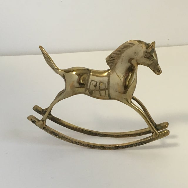 An adorable vintage brass rocking horse figurine. This little guy is so cute and would look great in a nursery. Overall...