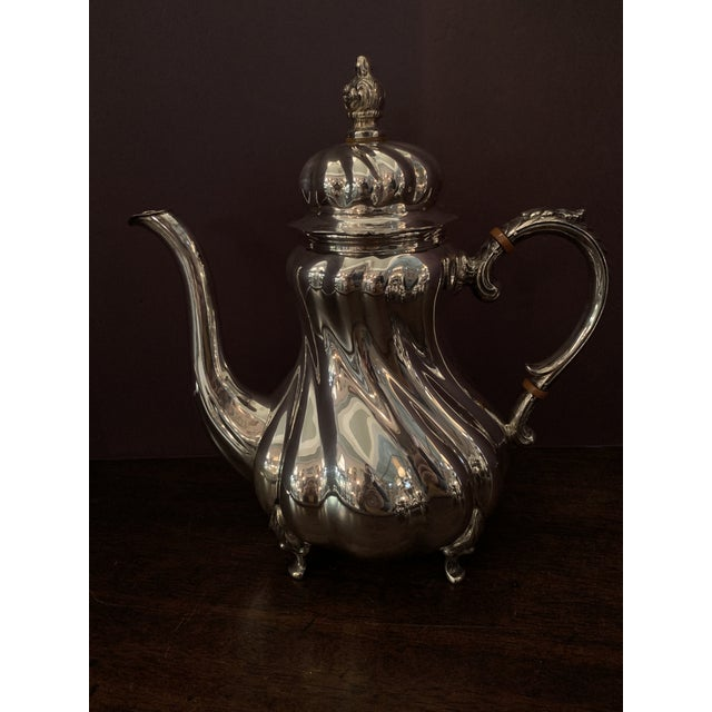 "4pc. Sterling Silver Coffee & Tea set Handarbeit, meaning ""hand-made"" Coffee Pot is approx. 11"" H Tea Pot approx. 9.5"" H..."