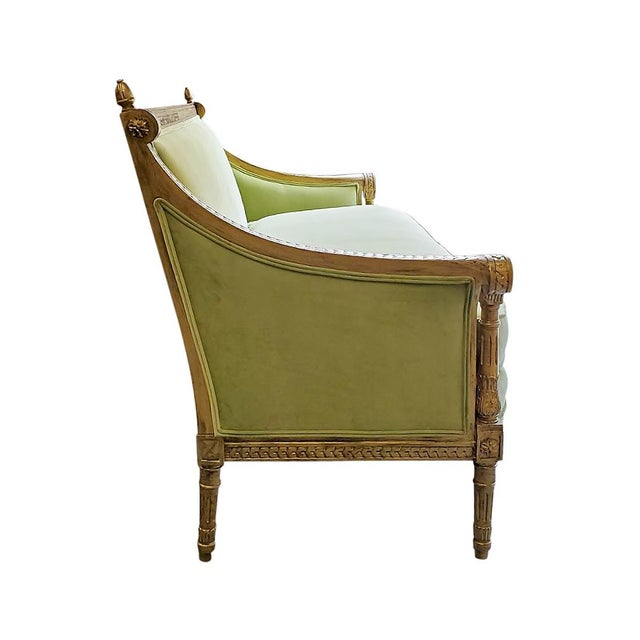 Green french style settee. This solid wood settee features new upholstery, and an aged gilt finish on the frame....