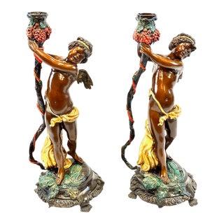 19th Century Bronze Cherubs Raising Urns - a Pair For Sale