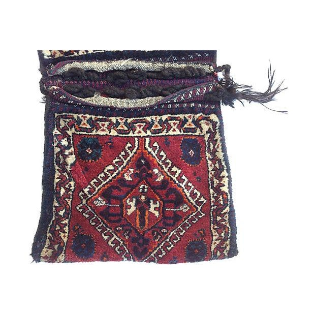Turkish camel sack or saddlebag, handwoven from pure wool in western Turkey and influenced by primitive geometrical...