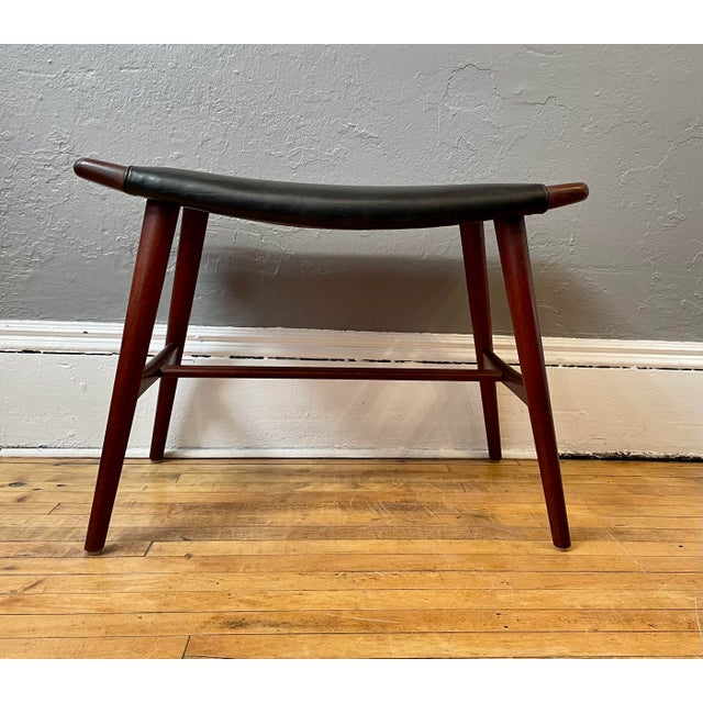 Early 1950s Teak and Black Leather Piano Stool designed by Hans Wegner for AP Stolen. Nice deep rich tones to the teak...