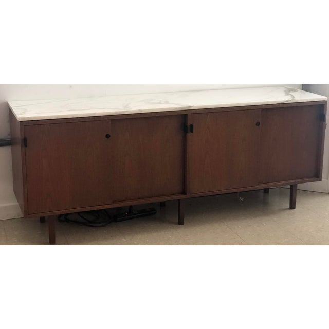 Height of the era piece designed by Florence Knoll for Knoll Associates. This professionally restored credenza is...