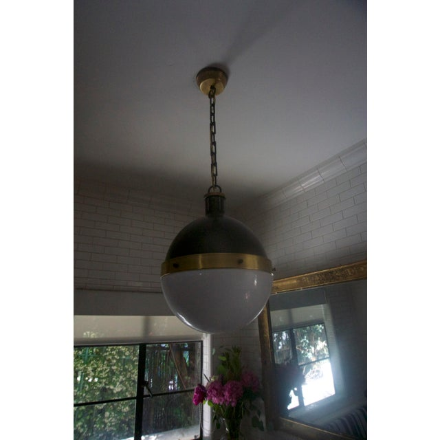 From the personal collection of Shay Mitchell. Great single pendant light fixture with milk glass shade and dark metal &...