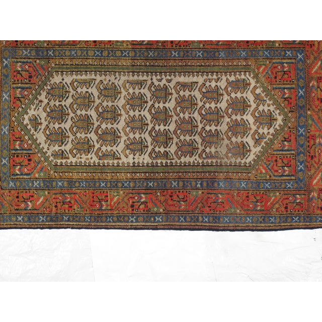 Wool pile hand woven antique Persian Bakhshayesh rug in excellent condition. This rug is beige and red!