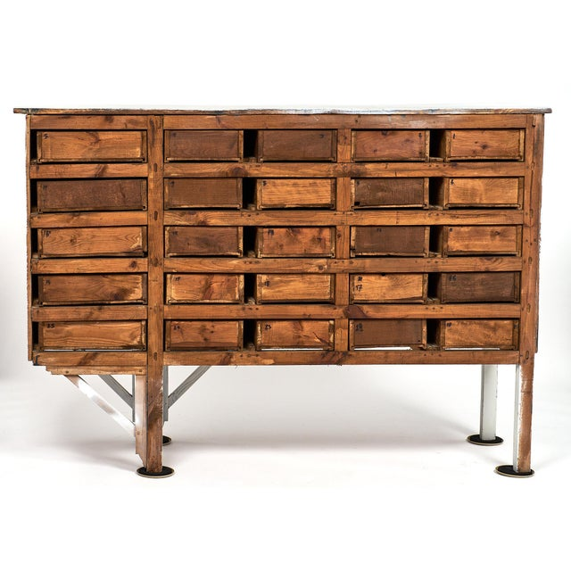 """Unique and authentic antique Haberdashery cabinet from a late 19th century """"Mercerie"""" in Lyon, France. This piece has an..."""