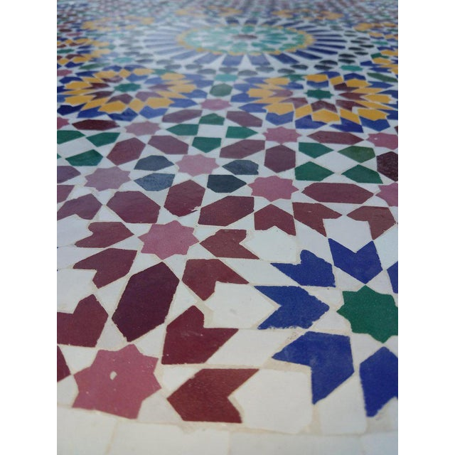 """Multicolor custom-made Moroccan mosaic table measuring 48"""" in diameter. An indoor / outdoor dining table that sits up to..."""