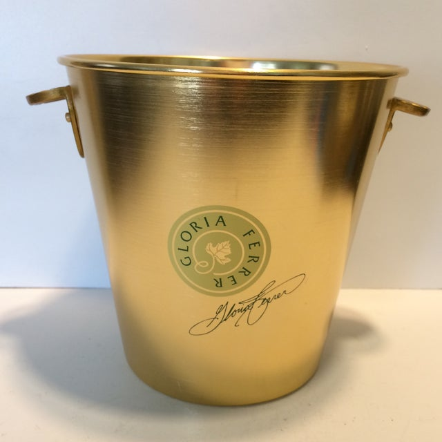 This Gold Anodized Gloria Ferrer Champagne Bucket is in excellent shape with no scratches or dents. Embrace the Napa...