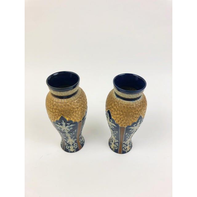 This pair of matching vases works well with either a contemporary or transitional room. There are four repeating vertical...