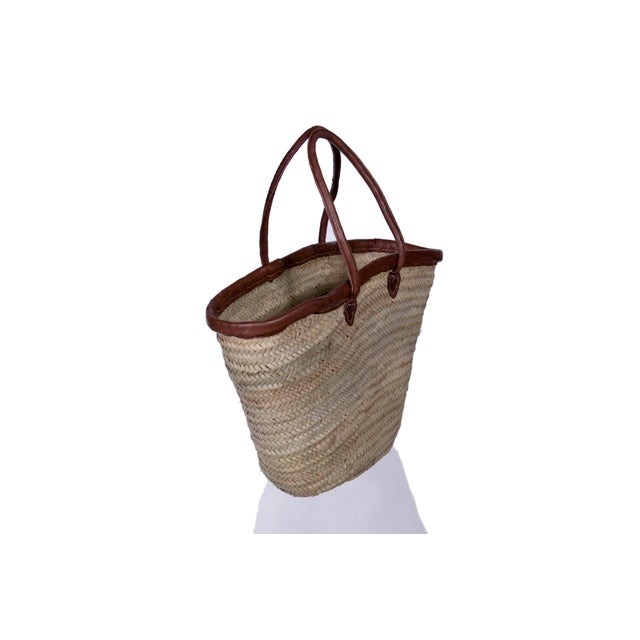 This is a classic Moroccan/ French market basket! It is very lightweight, yet durable for your loads. Leather embroidery...