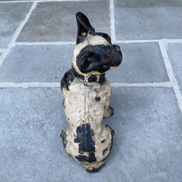 Cast iron seated French Bulldog doorstop, in the manner of Hubley. Sweet face and studded collar, with perfectly aged patina.