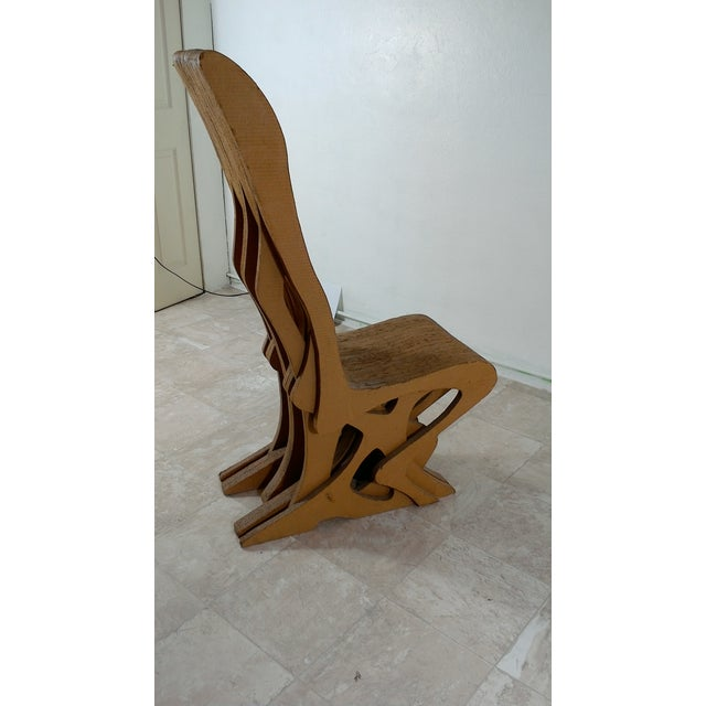 Vintage cardboard chair, circa 1970 in good condition , shows wear according to its age. It could easily be a Frank gehry...